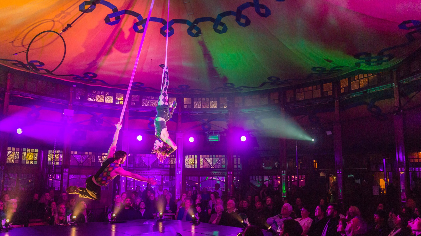 aerial strap artists flying across the stage