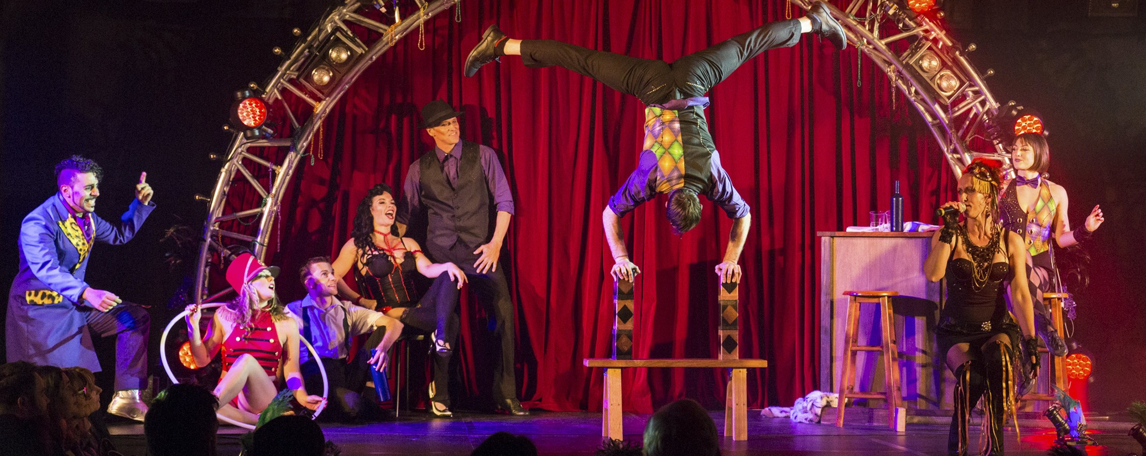 circus artists performing circus acts in a venue as part of a customised show